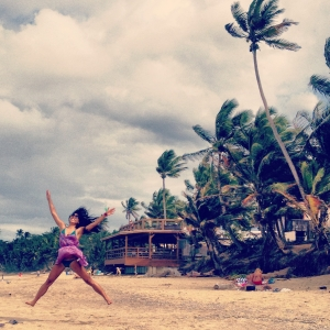 Sandy Beach, Rincon, PR, is a long stretch of beach with surfers and all sorts of beach goers