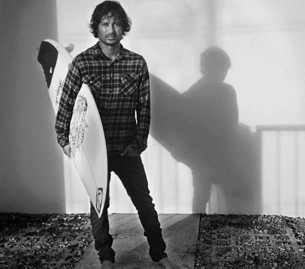 smm_interview_CarlosSanchez_withsurfboard