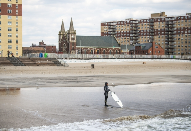 Winter surfing and Rockaway's historical surrounding.    Photo: Andreea Water