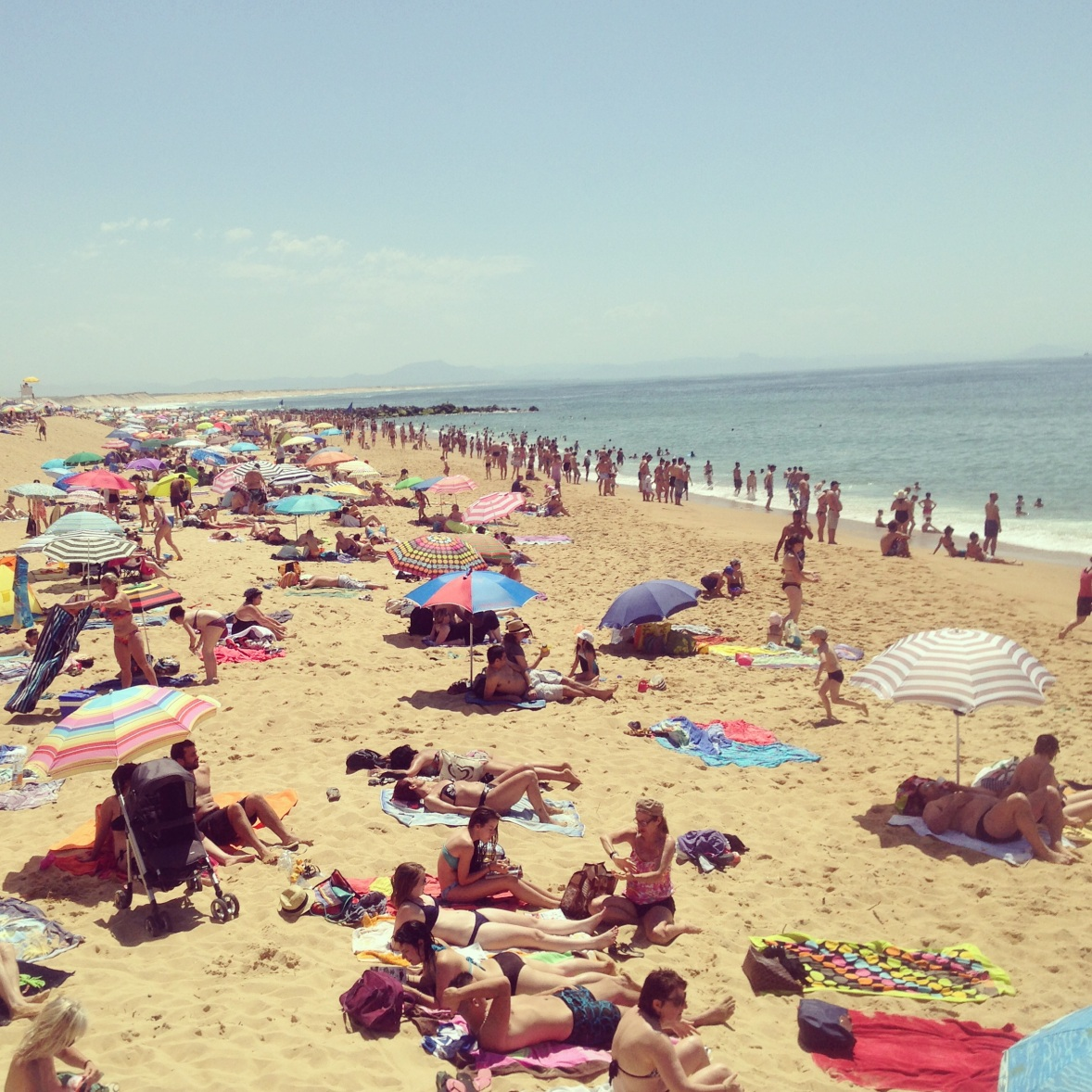 I visited Caperton at a French holiday.  It is a very crowed beach with a nice long stretch of boardwalk and lively environment